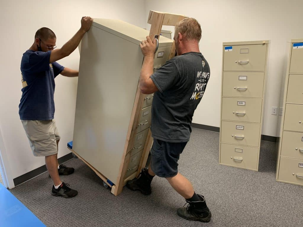 Two of our movers handling large office items.