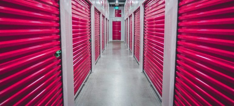 storage units with red rolling doors
