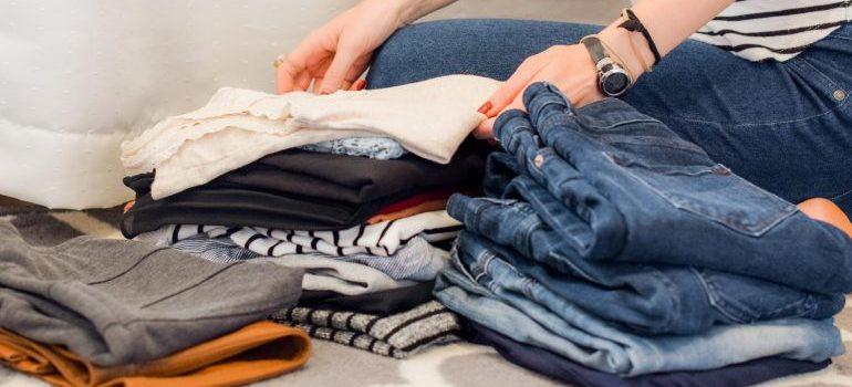 A woman folding clothes.