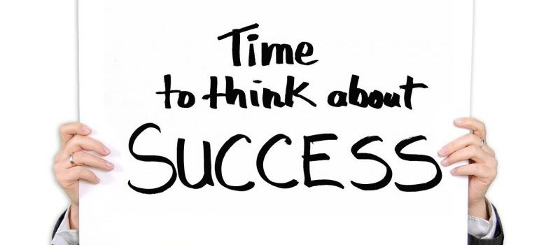 A sign saying time to think about success.