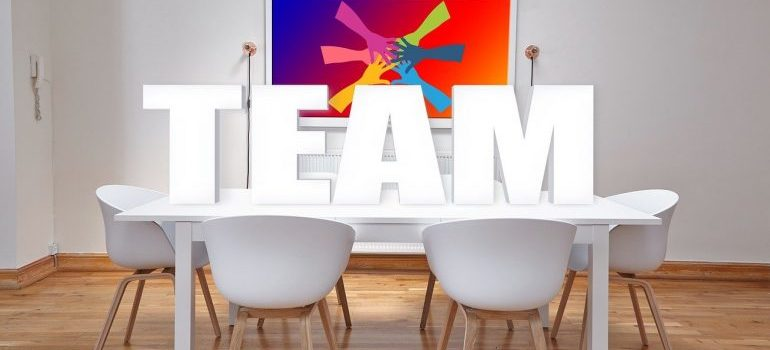 The word team placed on a desk in an office.
