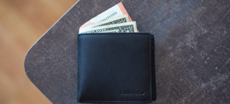 A black wallet with dollars and euros.