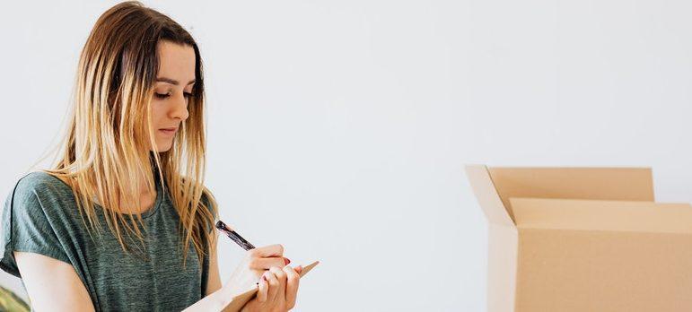 A woman writing stuff down