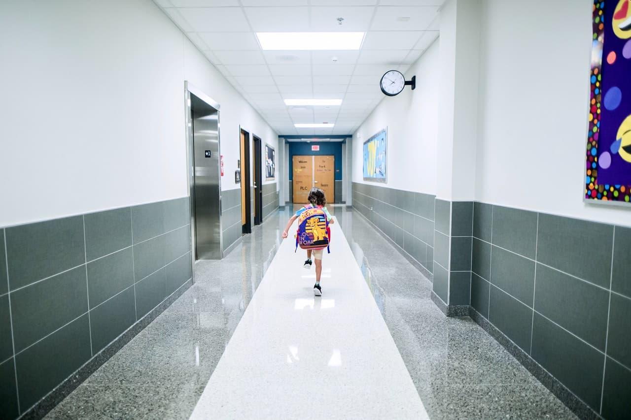 boy running in a school
