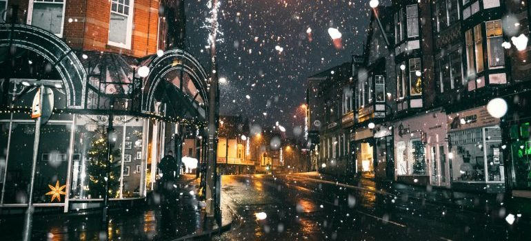Snowing in town at night