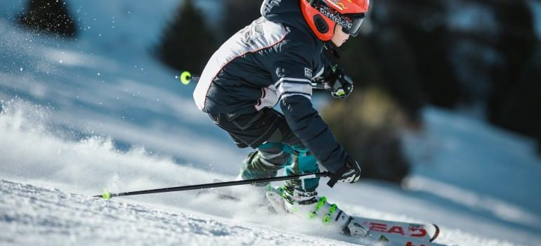 Man skiing on snow field