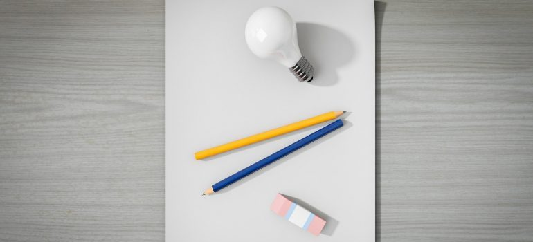 Paper, pencil, rubber and a lightbulb